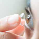 Lady inserting contact lens