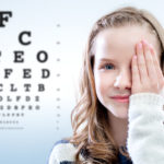 Young Lady Reading Eye Chart